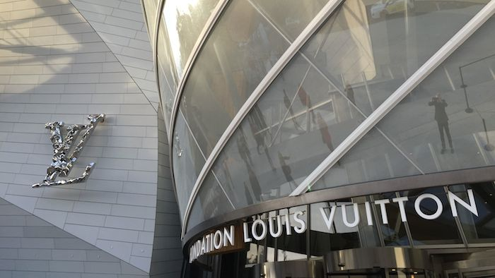 The famous LV logo cast in aluminum marks the front entrance of Paris' latest art center. For the opening, the exhibitions inside rightly take a lesser role and the building itself, like the eye catching packaging of a luxury product, becomes paramount. Later on, as the new Director and Curators find their stride, what's inside the packaging (the Art) will move to center stage.