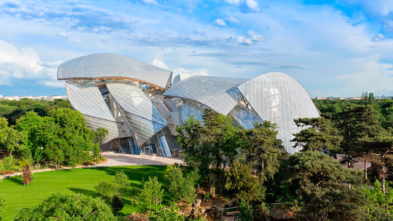 Fondation Louis Vuitton by Frank Gehry seen in the green landscape of the Bois de Boulogne park in Paris. Copyright Fondation Louis Vuitton/Louis-Marie Dauzat.