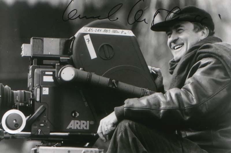 Bernardo Bertolucci on the set where he seems to be happy