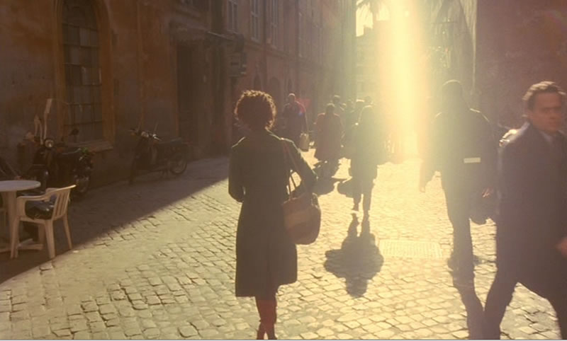 Shandurai (played by Thandie Newton) heads home from medical school through the bustling crowds on the streets of Rome.
