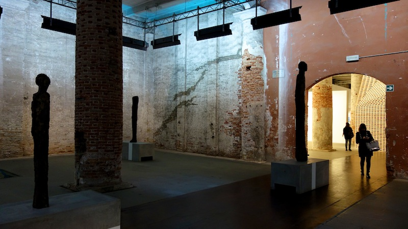 Peter Markli, a Swiss architect, created this room with Steve Roth. Elegant, elongated, ectomorphic statues blend perfectly with the giant columns in the Arsenale. One of these statues was actually a Giacommetti (but I am not sure which one).