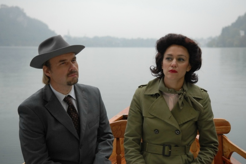 "Production still from ""Framing the Space."" Katarina Stegnar plays the journalist ""Linda"" and Grega Zorc plays the ""real life"" Architect, Vinko Glanz. A trailer is available for you to see here.   Photo by Pete Moss courtesy of the artist and Galerija Škuc, © Jasmina Cibic, All Rights Reserved."
