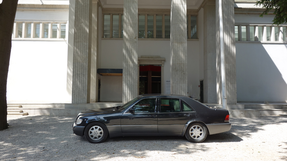 The Chancellor's bulletproof 1980's vintage Mercedes waits patiently outside the German Pavilion adding an understated artistic flourish to a smart and beguiling installation.