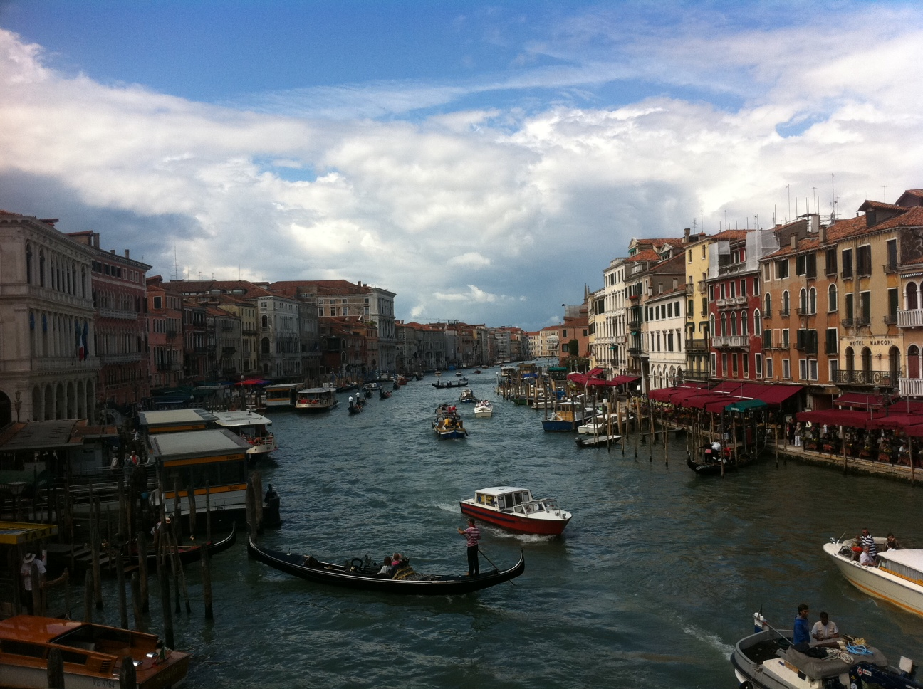 I snapped this photo from the top of the Venice's Rialto bridge with an iPhone 4S. It took all of 15 seconds to take it and then send it to friends around the world.